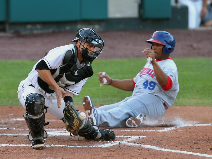 Buffalo's Cory Aldridge beats the throw home to Rochester catcher Dan Rohlfing during Tuesday night's game at Frontier Field.