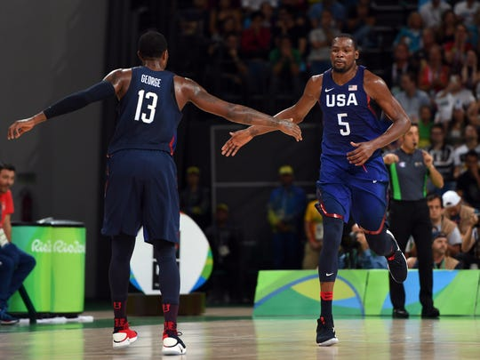 Paul George (13) and Kevin Durant (5) celebrate against