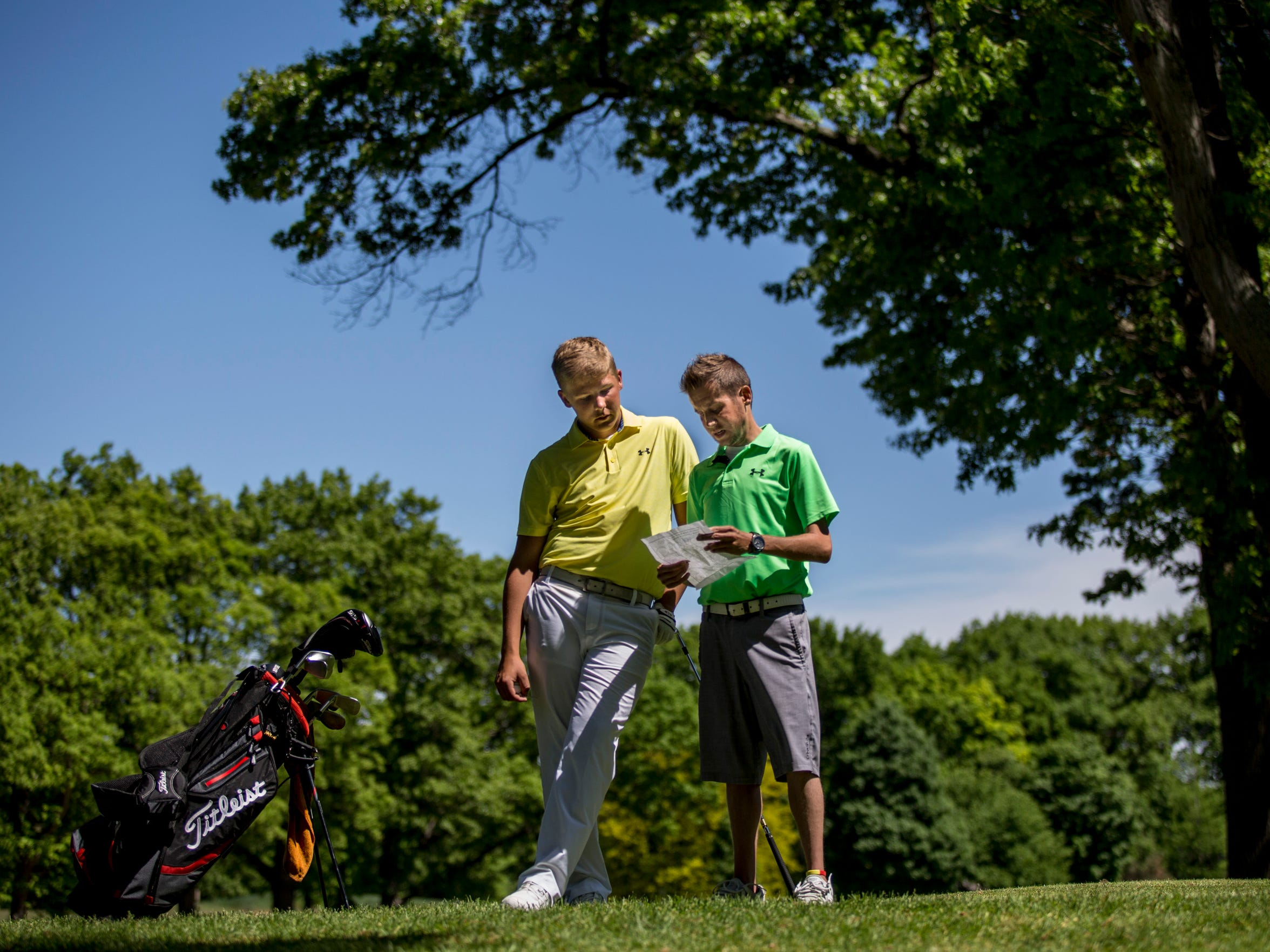 Nick Bailey, right, talks strategy with his brother Kyle Bailey between holes Friday, June 3, 2016 at the Port Huron Golf Club.