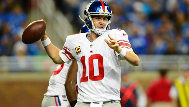 Dec 22, 2013; Detroit, MI, USA; New York Giants quarterback Eli Manning (10) throws a pass during the first quarter against the Detroit Lions at Ford Field. Mandatory Credit: Andrew Weber-USA TODAY Sports