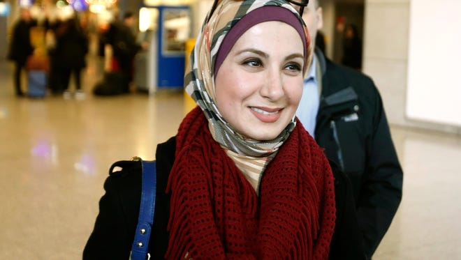 Sarah Hekmati, sister of Amir Hekmati, smiles as she arrives at the airport in Frankfurt, Germany, Monday, Jan. 18, 2016, the day after former US marine Amir Hekmati landed safely in Geneva and was transferred to Germany after being released from prison in Iran on Saturday.