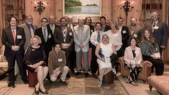 Harbor Branch Oceanographic Institute Foundation President Katha Kissman, seated left, with the 2018 Love Your Lagoon honorees, seated or kneeling, from left, Guojun Wang, Esther Guzman, Marilyn Mazzoil and Anni Vuorenkoski Dalgleish. Standing, from left: Jim Sullivan, Dennis Hanisak, Adam Schaefer, Brian Lapointe, Matt Ajemian, Peter McCarthy; Michael O'Reilly, chair, HBOIF board of directors; Laurent Cherubin, Mingshun Jiang, Michael Twardowski, Amy Wright, Nick Dickens, Fraser Dalgleish, and Paul Wills. The honorees are the Harbor Branch Oceanographic Institute Principal Investigators funded by the foundation.