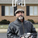 John Rossignol flies one of his photography drones outside the offices of the Granville Investment Group. Rossignol is a veteran professional aerial photographer as well as executive vice president of the Granville Investment Group.