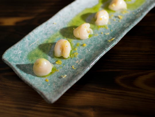 Scallop Credo seems to draw from a Mediterranean influence with its stark presentation, dressed simply in yuzu juice and scallion oil.