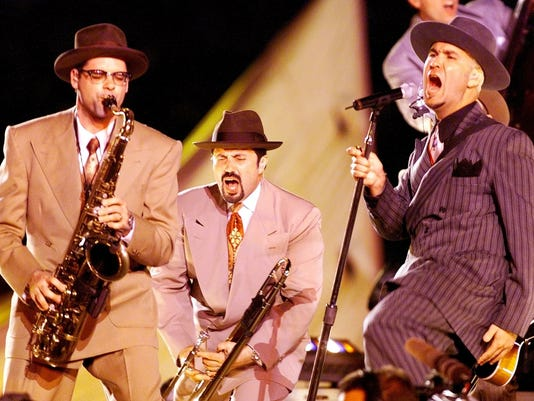 Swing b and Big Bad Voodoo Daddy performs during t