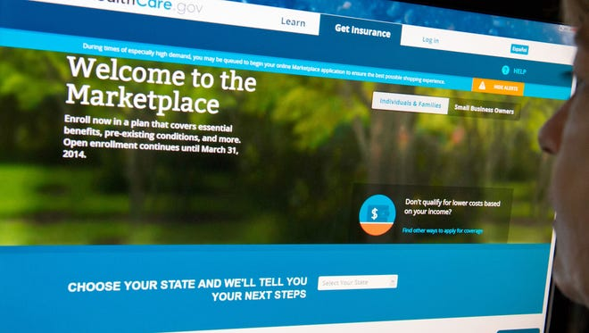 This December 2, 2013 file photo shows a woman reading the HealthCare.gov insurance marketplace internet site in Washington, DC.