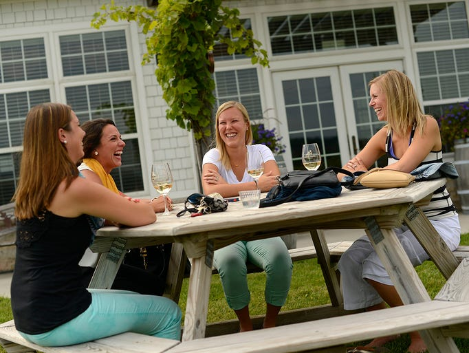 From left, Shannon Sutton, Toni Maretti, Nicole Herzog and Rachael Buck share laughs as they enjoy wine during the third annual Wisconsin Ledge AVA Celebration at Ledgestone Vineyards in Greenleaf on Saturday, Aug. 16, 2014. Evan Siegle/Press-Gazette Media