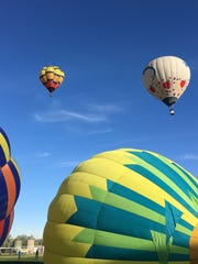 Hot air balloons inflate and take off from the Chamblee Soccer Complex at the Boys & Girls Club of Bloomfield during the San Juan River Balloon Rally June 16 in Bloomfield.