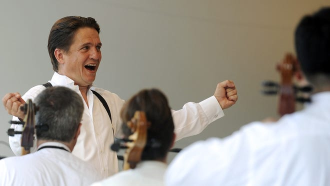 Keith Lockhart conducts the Boston Pops Esplanade Orchestra at a past Citizens Bank Pops by the Sea concert in Hyannis. Tonight's show will be virtual at artsfoundation.org, and will include Pops music Lockhart chose for the video, a nod to his 25th anniversary with the Pops, and a video meet-up between him and actor Neal McDonough, as guest celebrity conductor.