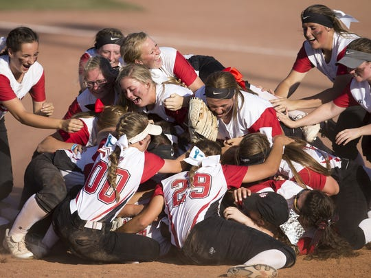 New Palestine celebrates as it beat Kankakee Valley 13-6 for the 3A state softball title, from Ben Davis High School, June 10, 2017.
