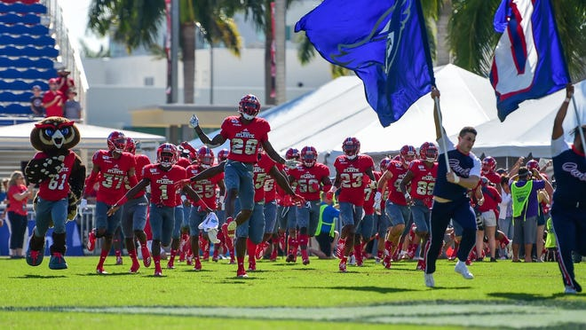 The Florida Atlantic Owls run onto the field before playing UAB in the Conference USA Championship game on Saturday, Dec. 7, 2019 in Boca Raton.