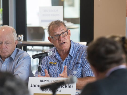 State Rep. James Strickler, R-Farmington, addresses questions to Public Regulation Commission member Sandy Jones Wednesday during a Legislative Finance Committee meeting at the San Juan College School of Energy in Farmington.