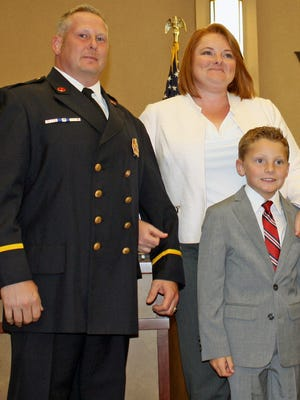 Lt. Randy Hanifen was promoted to shift captain by West Chester Twp. trustees. He is pictured with his wife, April, and son, Jack.