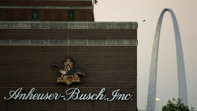 The Anheuser-Busch brewery is seen in the foreground as the Gateway Arch is seen in the distance in St. Louis.