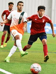 The Michigan Bucks' Daniel de Oliveira (left) makes the pass in Sunday's PDL match against Chicago.