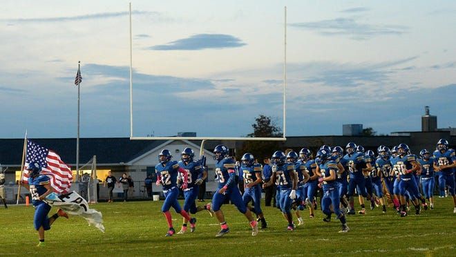 The Seneca football team runs onto Bob Diffenbacher Field on Oct. 11, 2019. The Seneca athletic department's COVID-19 safety plan has been completed and approved by the Wattsburg School Board. However, Seneca teams cannot begin working out until the arrival of thermometers and other equipment that athletic director Steve Carter has ordered.