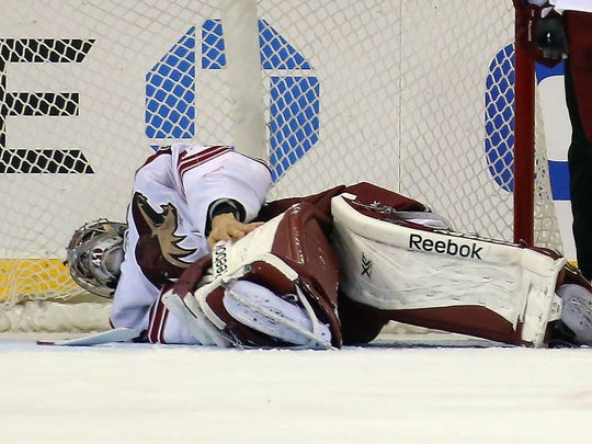 Mike Smith had to leave the game against the New York Rangers after being injured at Madison Square Garden on March 24, 2014 in New York City.