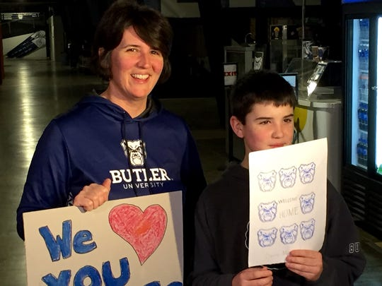 Butler fans greet the Bulldogs after they got off the bus at Hinkle Fieldhouse today.