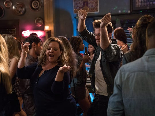 Deanna (Melissa McCarthy) gets her groove on with a