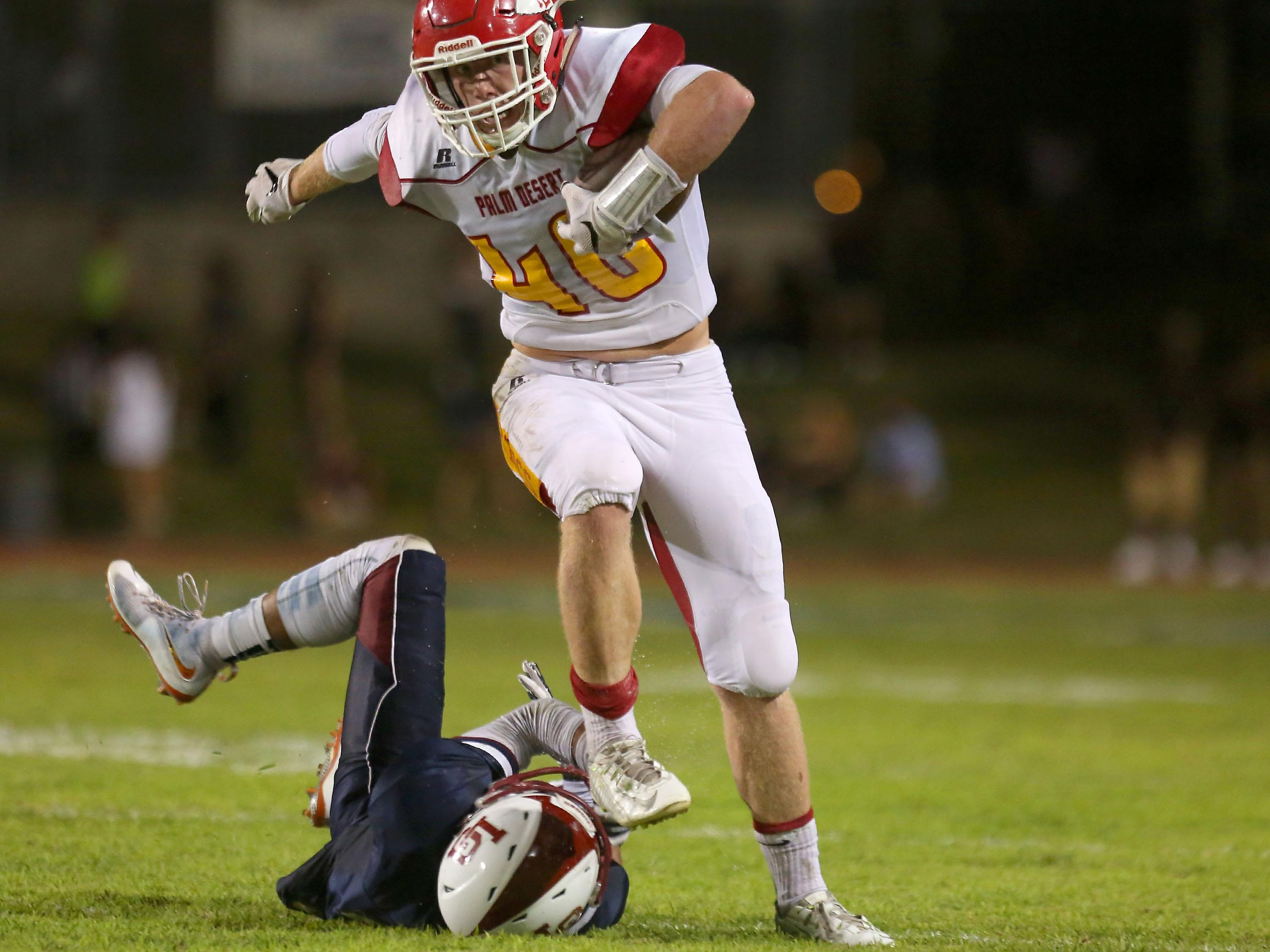 Palm Desert receiver Tommy Jacobson catches a ball and picks up a fist down against La Quinta, Friday, September 25, 2015.
