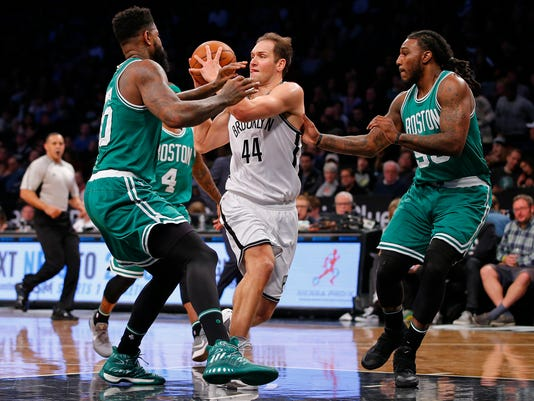Brooklyn guard Bojan Bogdanovic (44) looks to pass the ball as Boston Celtics forwards Amir Johnson, left, and Jae Crowder defend during the first half of an NBA basketball game in New York, Wednesday, Nov. 23, 2016. (AP Photo/Rich Schultz)
