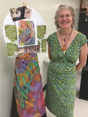 """Camille S. poses in front of her display on July 7, at the CAHA Gallery in Hagatna at the opening of her Hacha Ha' Rock Show """"An Interactive Art Show For All Ages"""".  The CAHA Gallery is open 8 a.m. to 5 p.m. Monday through Friday."""