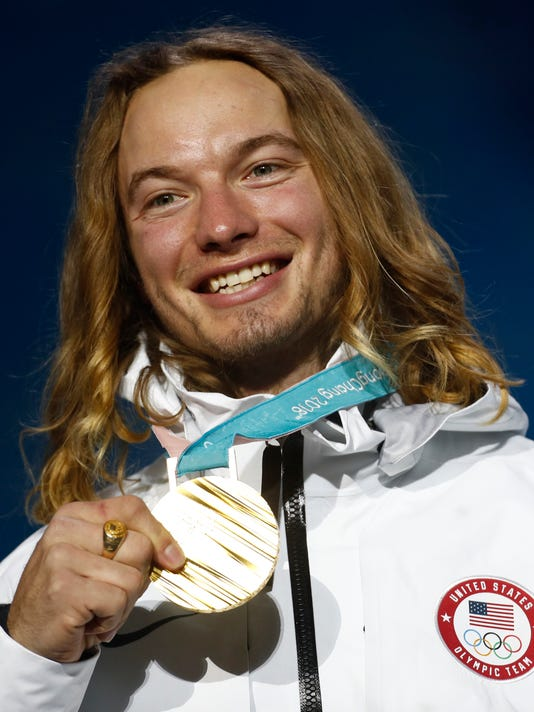 Gold medalist in the men's halfpipe David Wise, of the United States, poses during the medals ceremony at the 2018 Winter Olympics in Pyeongchang, South Korea, Thursday, Feb. 22, 2018. (AP Photo/Patrick Semansky)