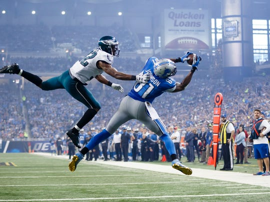 In this Nov. 26, 2015, file photo, Detroit Lions wide receiver Calvin Johnson (81), defended by Philadelphia Eagles cornerback Eric Rowe (32), catches a pass for a touchdown during the second half in Detroit.