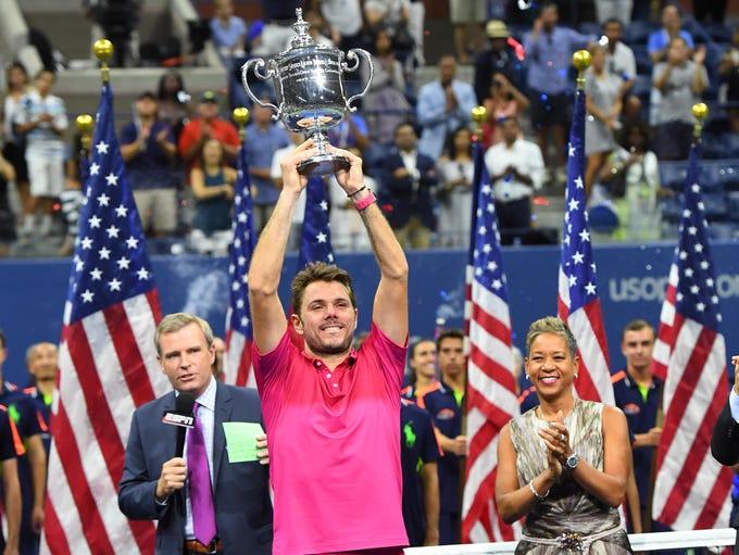 Stan Wawrinka celebrates with the championship trophy