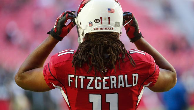 Arizona Cardinals wide receiver Larry Fitzgerald gets ready to play the New Orleans Saints at University of Phoenix Stadium in Glendale, Arizona, on Dec. 18, 2016.