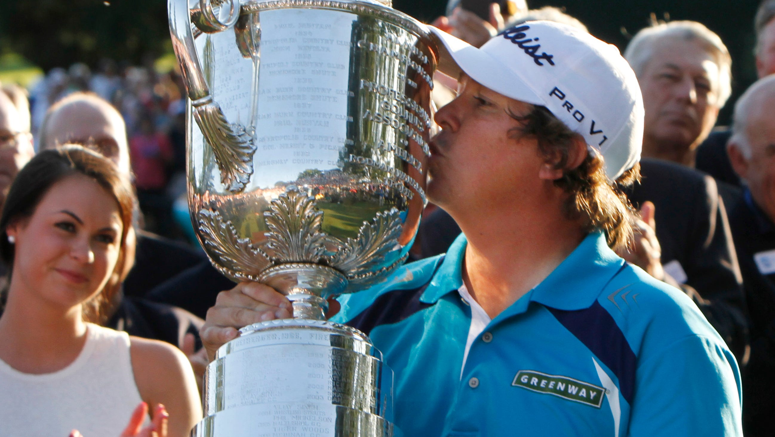 Jason Dufner kisses the Wanamaker Trophy as wife Amanda looks on following his two stroke victory at the final round of the 95th PGA Championship Sunday, Aug. 11, 2013 at Oak Hill Country Club in Pittsford.