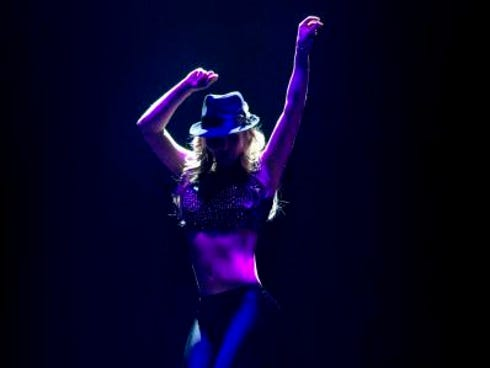 Britney Spears strikes a Michael Jackson-like pose during 'Me Against the Music,' a song from her new Las Vegas residency show, 'Britney: Piece of Me,' which debuts Friday but had a final invitation-only run-through Thursday at Planet Hollywood.