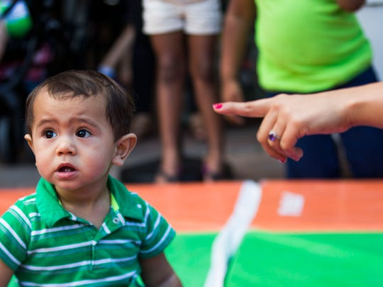 Samuel Luces, 1, of Fort Myers races in the leprechaun races at Miromar Outlets in Estero on Sunday, March 12, 2017.
