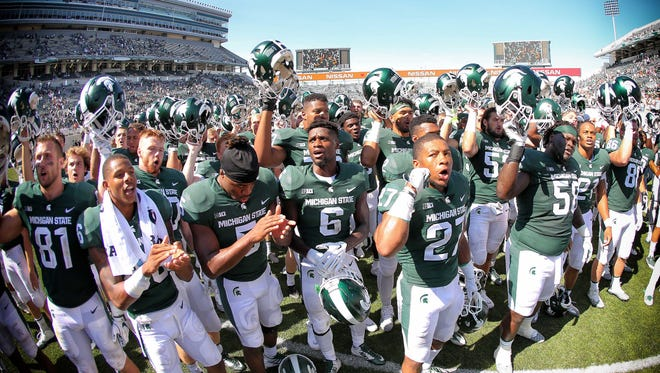 Sep 2, 2017; East Lansing, MI, USA; Michigan State Spartans celebrate a win over Bowling Green Falcons after a game at Spartan Stadium. Mandatory Credit: Mike Carter-USA TODAY Sports