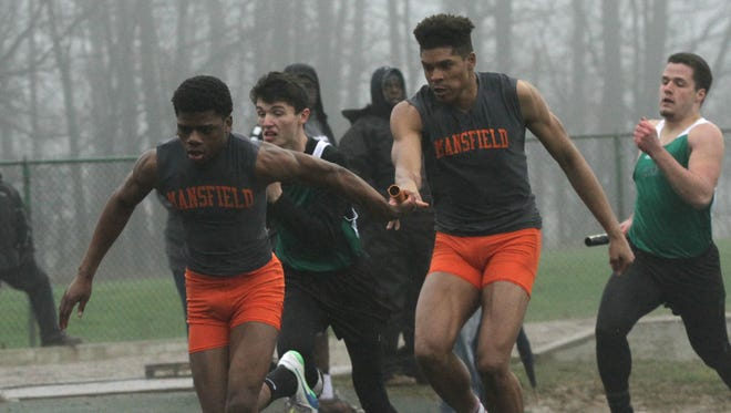 Mansfield Senior's Joe Ellis hands the baton off to Angelo Grose in the 4x200 meter relay at last Friday's Madison Invitational.