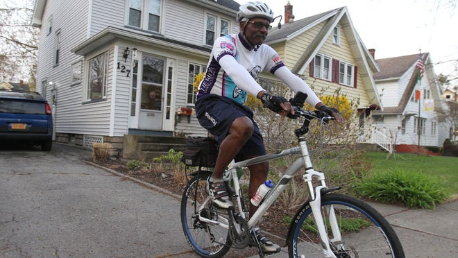 Dave Abercrombie of Irondequoit heads from his home to work in downtown Rochester. Abercrombie is head of the Roc City Cycling Foundation, which helps educate cyclists on the rules of the road.
