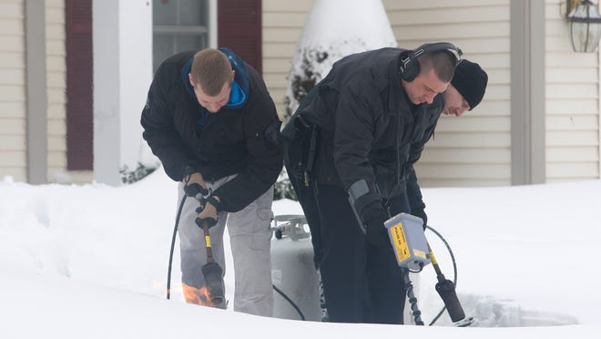 Investigators with the Monroe County Sheriff's Office investigates the fatal shooting at 37 Coach Side Lane in Pittsford on Feb. 10, 2015.