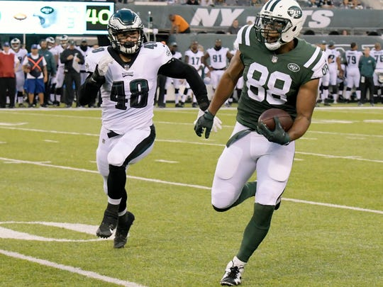 FILE - In this Thursday, Aug. 31, 2017 file photo, New York Jets tight end Austin Seferian-Jenkins (88) runs with the ball as Philadelphia Eagles linebacker Don Cherry (48) chases after him during the first half of an NFL football game in East Rutherford, N.J. Austin Seferian-Jenkins spent the past two Sundays holed up alone in his home while watching his New York Jets play on TV, eager to be out there again with his teammates. With his two-game suspension for violating the NFL's substance abuse policy over, the tight end could get that chance against Miami on Sunday, Sept. 24, 2017. (AP Photo/Bill Kostroun, File)