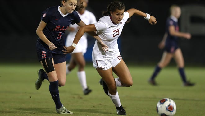FSU's Emily Madril fights off Ole Miss' CeCe Kizer during their NCAA Tournament game at the Seminole Soccer Complex on Friday.