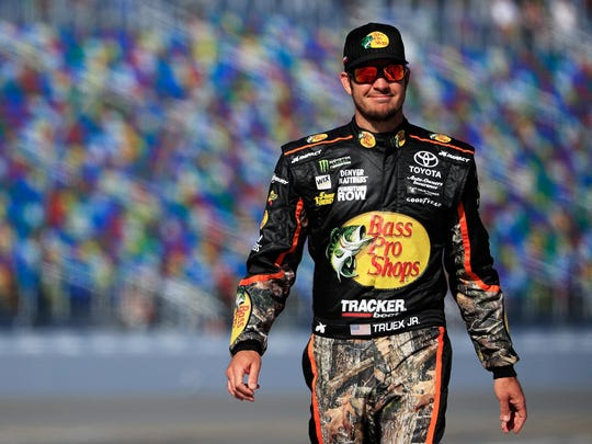 Martin Truex Jr., driver of the #78 Bass Pro Shops/TRACKER BOATS Toyota, stands on the grid during qualifying for the Monster Energy NASCAR Cup Series 59th Annual DAYTONA 500 at Daytona International Speedway on February 19, 2017 in Daytona Beach, Florida.