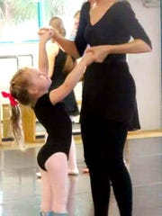 Layla McCarthy and her teacher Amy Trammell at Vero Classical Ballet. With Trammell's help, Layla can stand and perform moves, including her favorite position, the arabesque, like any other ballet student.