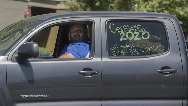 Omar Villapando leads the census caravan procession down Stanislaus Street at Church Street on Mega Census Day in south Stockton.
