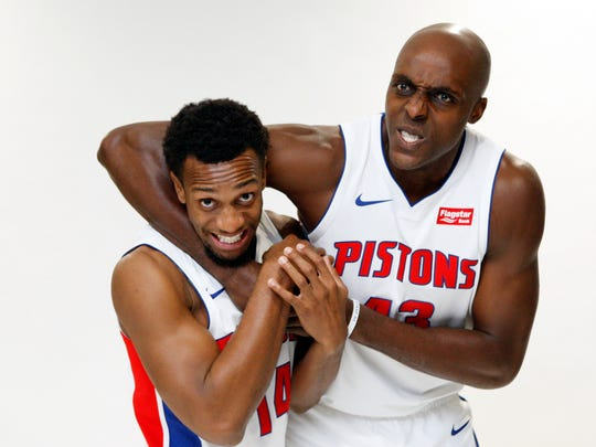 Detroit Pistons forward Anthony Tolliver, right,  gets guard Ish Smith in a headlock during media day at The Palace of Auburn Hills, Michigan.