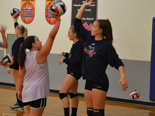 Bronson's Kiana Mayer works with a camper during the MIVCA All-Star Classic Clinic on Friday at Harper Creek.