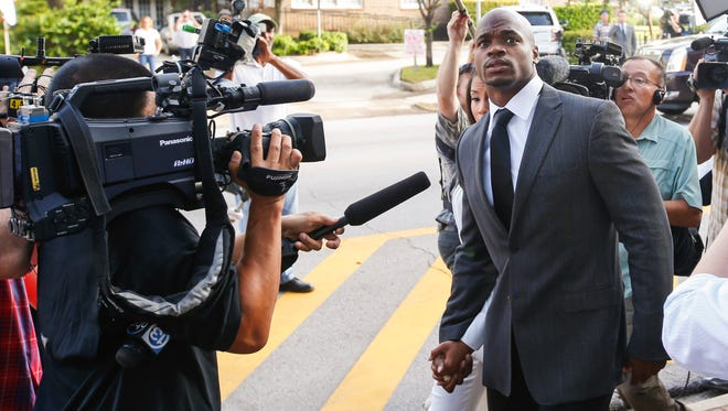 Oct 8, 2014; Conroe, TX, USA; Minnesota Vikings running back Adrian Peterson enters the Montgomery county courthouse for his arraignment.
