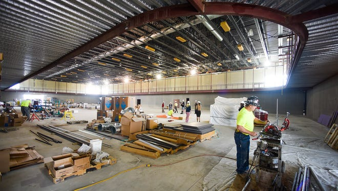 The walking track circles above the gym that is under construction Tuesday, June 27, at the new Sartell Community Center. The facility with a gym, library, senior center and meeting rooms is set to open this fall.