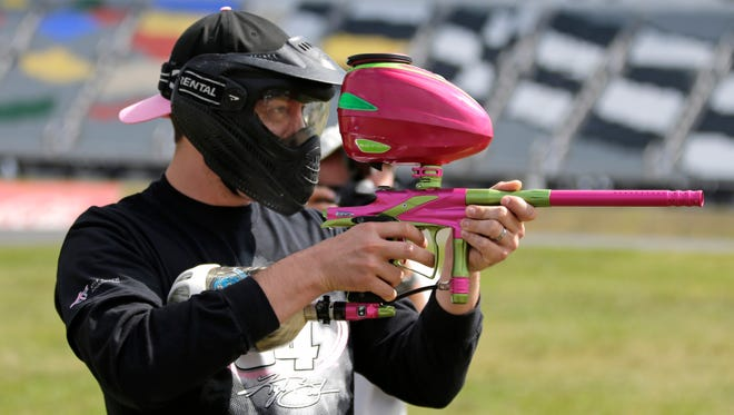 NASCAR driver Kyle Busch prepares for a paintball game against members of the media at Charlotte Motor Speedway.