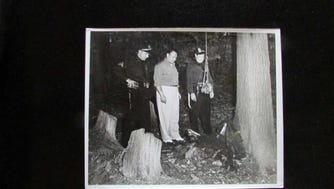 Police in 1949 view the remains of a dead man hanging from a tree in Hewitt woods. From left are Sgt. James Kemble, an unidentified investigator from the Passaic County Prosecutor's Office and Capt. Jack Ryan (later police chief).