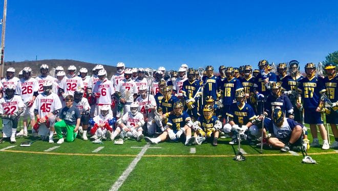 """The Boonton and Pequannock boys lacrosse teams come together before the """"Lax for Max"""" charity game."""