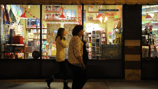 People walk past Mass Ave Toys. The toy store said in a tweet that it will be moving from its Mass Ave location.